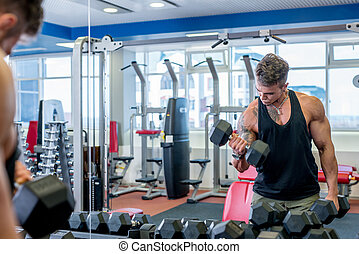 Man exercising with dumbbells in front of mirror