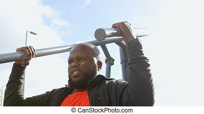 Man exercising with shoulder press machine 4k