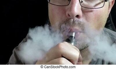 Man Exhaling smoke 120 FPS - Man Exhaling smoke from a...