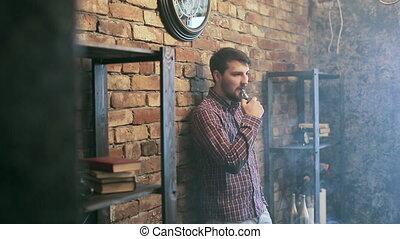 Man Exhaling smoke from a vaporizer shot