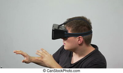 Man experiencing virtual reality with wearing special headset