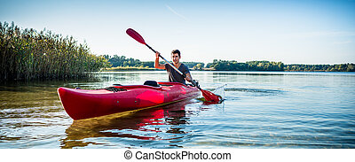Man explore the lake on kayak
