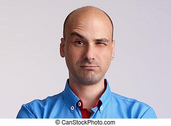 Man face with raised eyebrow