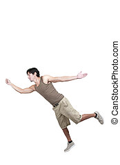 Handsome young man tripping slipping and falling