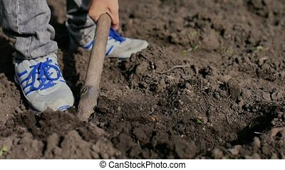 man farmer digs the ground old dirty shovel on dry ground...