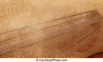 Man farmer driving combine harvesting on the field with...