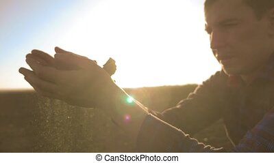 man Farmer Examines Soil Quality on Fertile Agricultural...