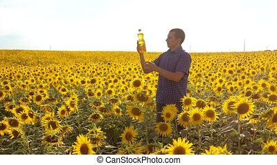 man farmer exploring the field lifestyle with sunflowers....