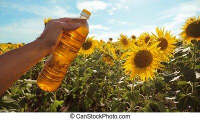 man farmer exploring the field with sunflowers. farmer...