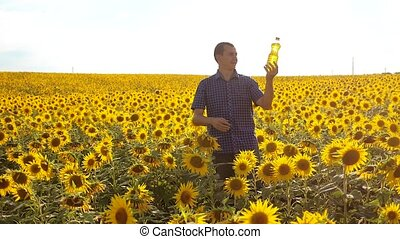 man farmer lifestyle exploring the field with sunflowers....