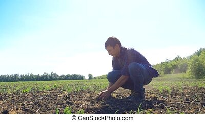 man farmer peasant hands holding fresh soil. slow motion...