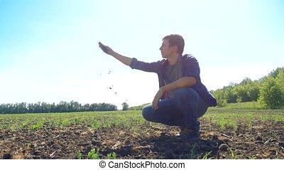 man farmer peasant hands holding fresh soil. slow motion...