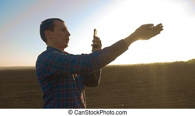 man farmer shoot scientist researcher pictures on the...