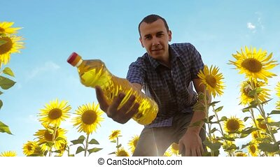 man farmer working holding in hand a plastic bottle...