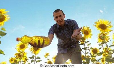 man farmer working holding in hand a plastic bottle...