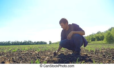 man farmer working peasant hands holding fresh soil. slow...