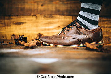 man fashion brown shoes on wood background with striped...