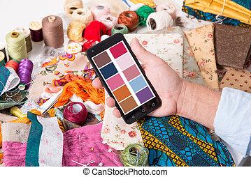 man fashion designer working with smartphone