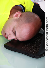 Man fast asleep at his desk
