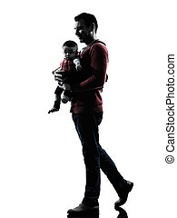 man father walking with baby silhouette