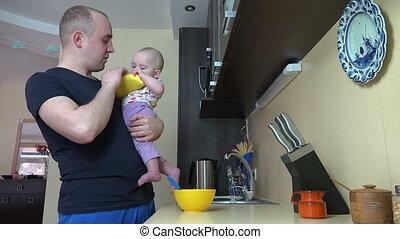 man feed baby girl