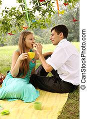Man feeding a woman