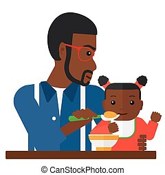 Man feeding baby. - An african-american dad holding a spoon...