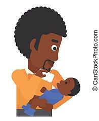 Man feeding baby. - An african-american man feeding a little...