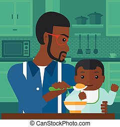 Man feeding baby. - An african-american man holding a spoon...