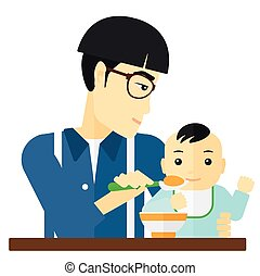 Man feeding baby. - An asian dad holding a spoon and feeding...