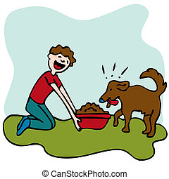 Man Feeding Dog Food - An image of a man feeding his dog...