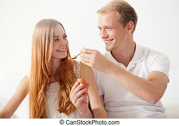 Man feeding his woman