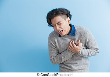 man feel heart pain isolated blue background, asian
