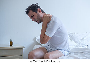 Man feeling back ache in the bed after sleeping