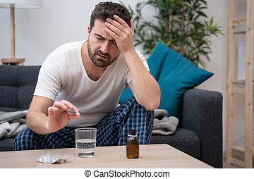 Man feeling bad head pain at home
