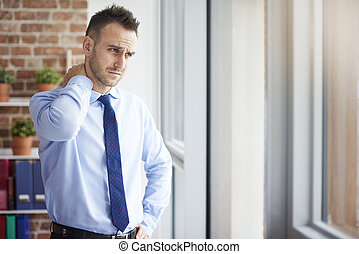 Man feeling pain in his neck