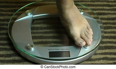 Man feet on a scale
