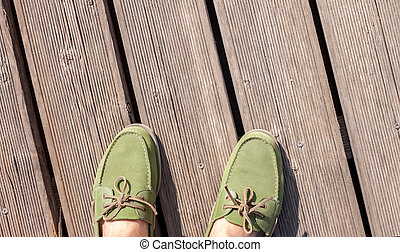 man feet standing on wooden floor
