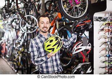 man fetch helmet for cycling