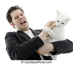 Man fighting with white cat. Isolated on white.