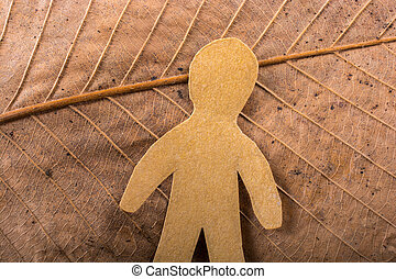 Man figurine on Abstract texture of leaf