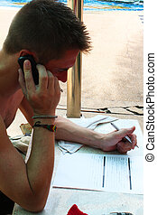 Man filling out a form outdoors.