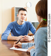 Man  filling questionnaire for employee