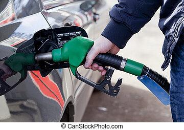 at petrol station - man filling up car with fuel at petrol...