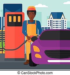 Man filling up fuel into car.