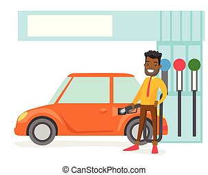 Man filling up fuel into the car at a gas station.