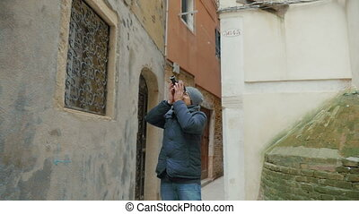 Man filming old architecture with retro camera - Slow motion...