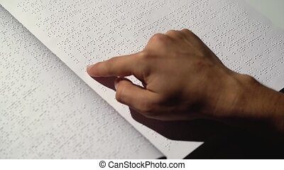 Man fingers read Braille writing. Close up - Man fingers...