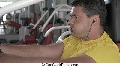 Man finishing set on chest press machine