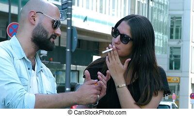 Man Fires Women Cigarette in City